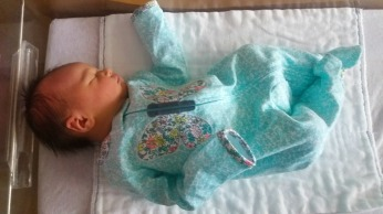 Swimming in her Newborn outfit